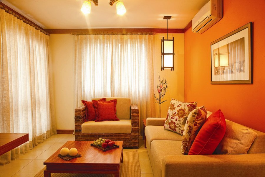 Vibrant orange hotel living room