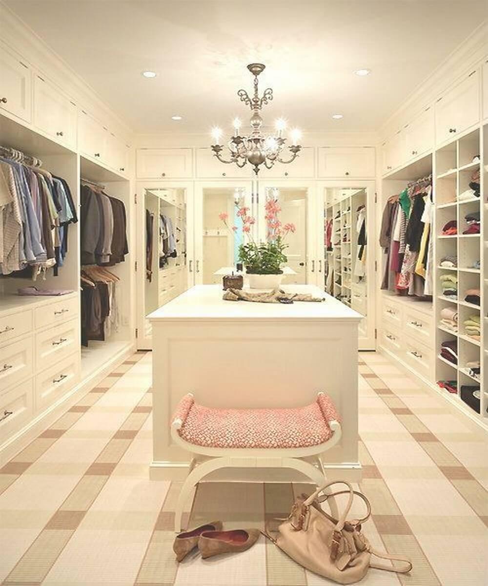 Bright white walk in closet with chandelier