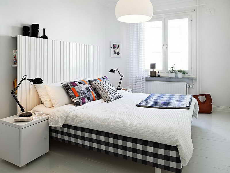 Scandinavian bedroom with black lamps