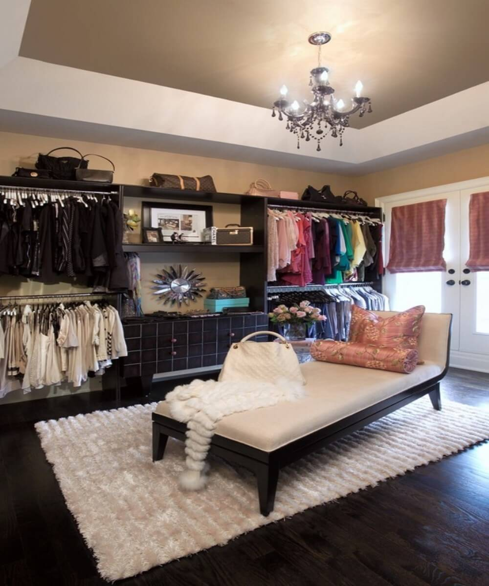 Gorgeous walk in closet with chaise lounge