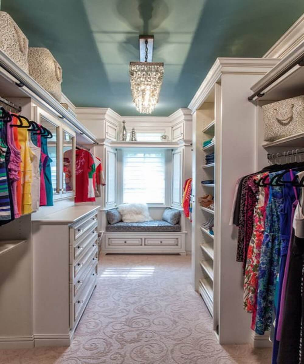 Glamorous walk-in closet with teal ceiling