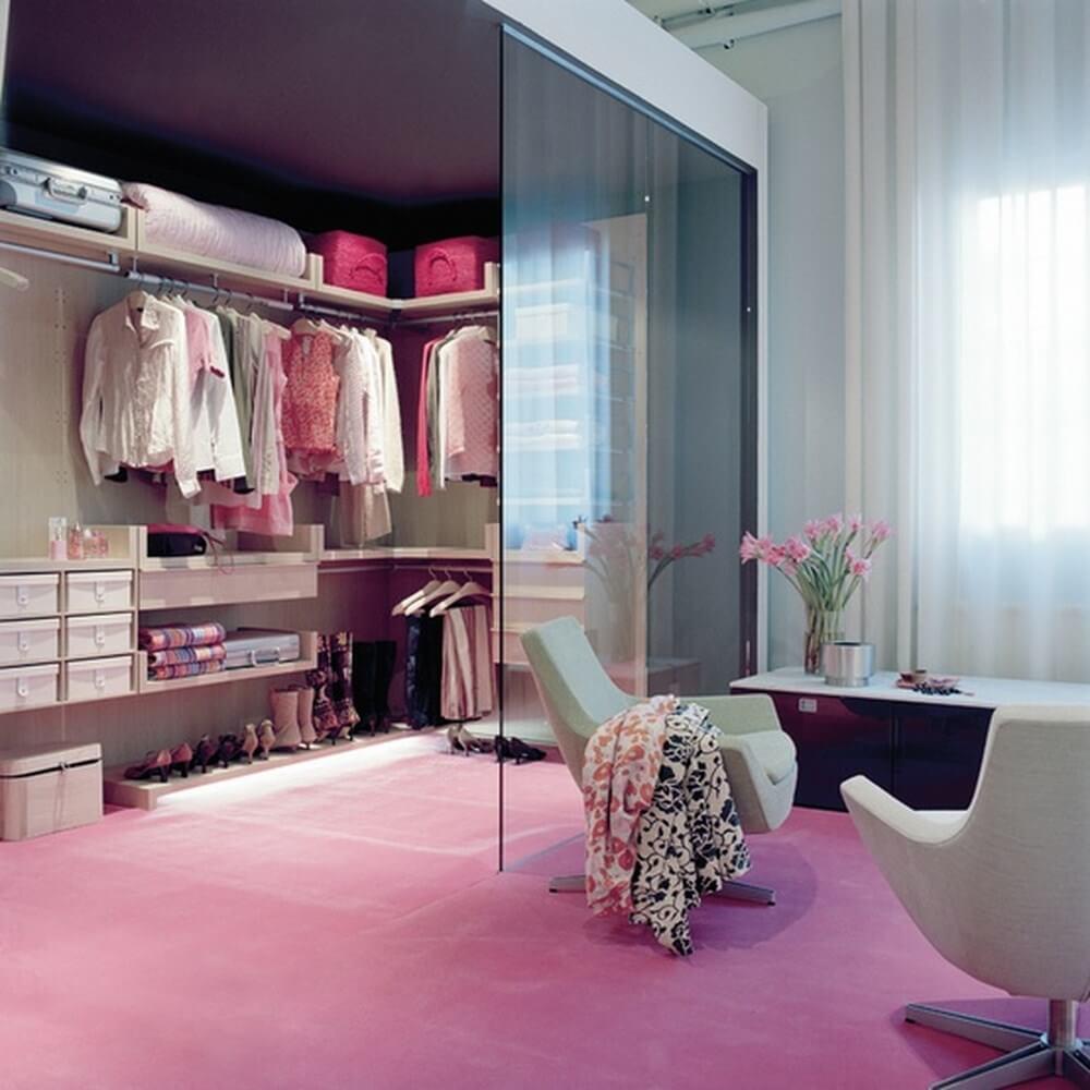 Stylish pink closet with glass wall