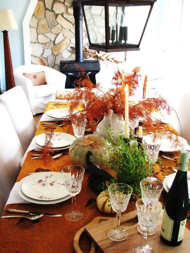 Dining room table decorated for autumn