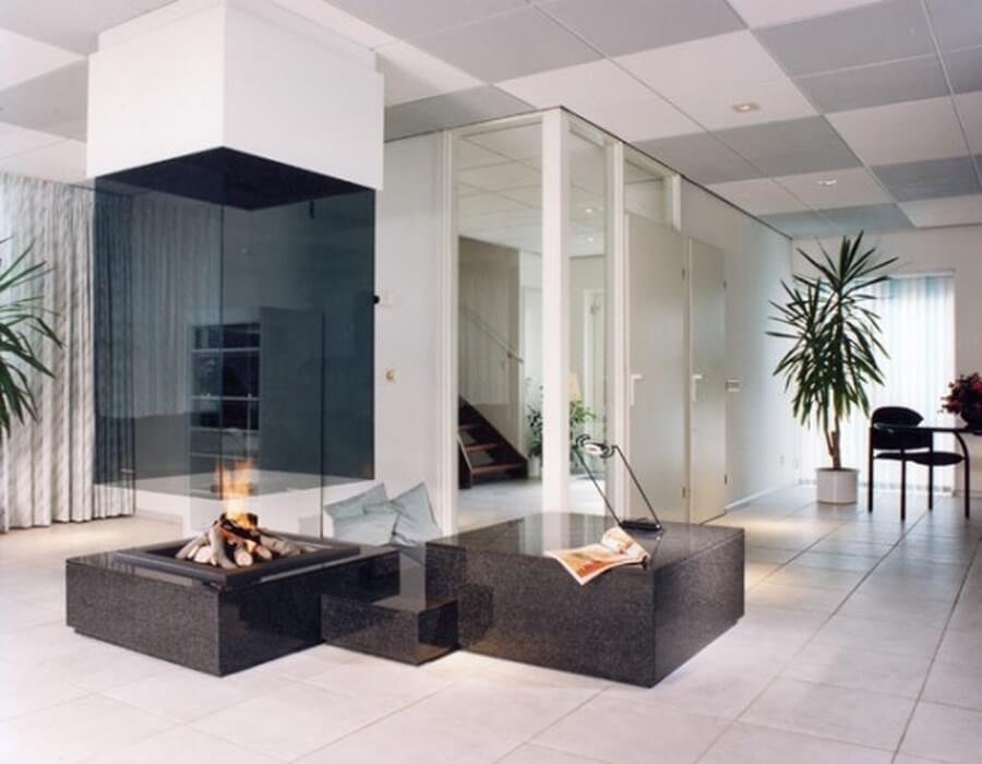 Glass fireplace in a modern living room.