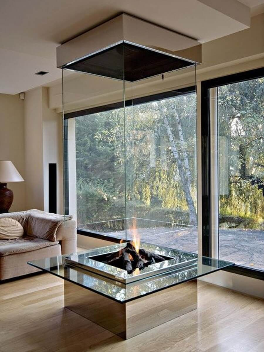 Glass fireplace by big living room windows
