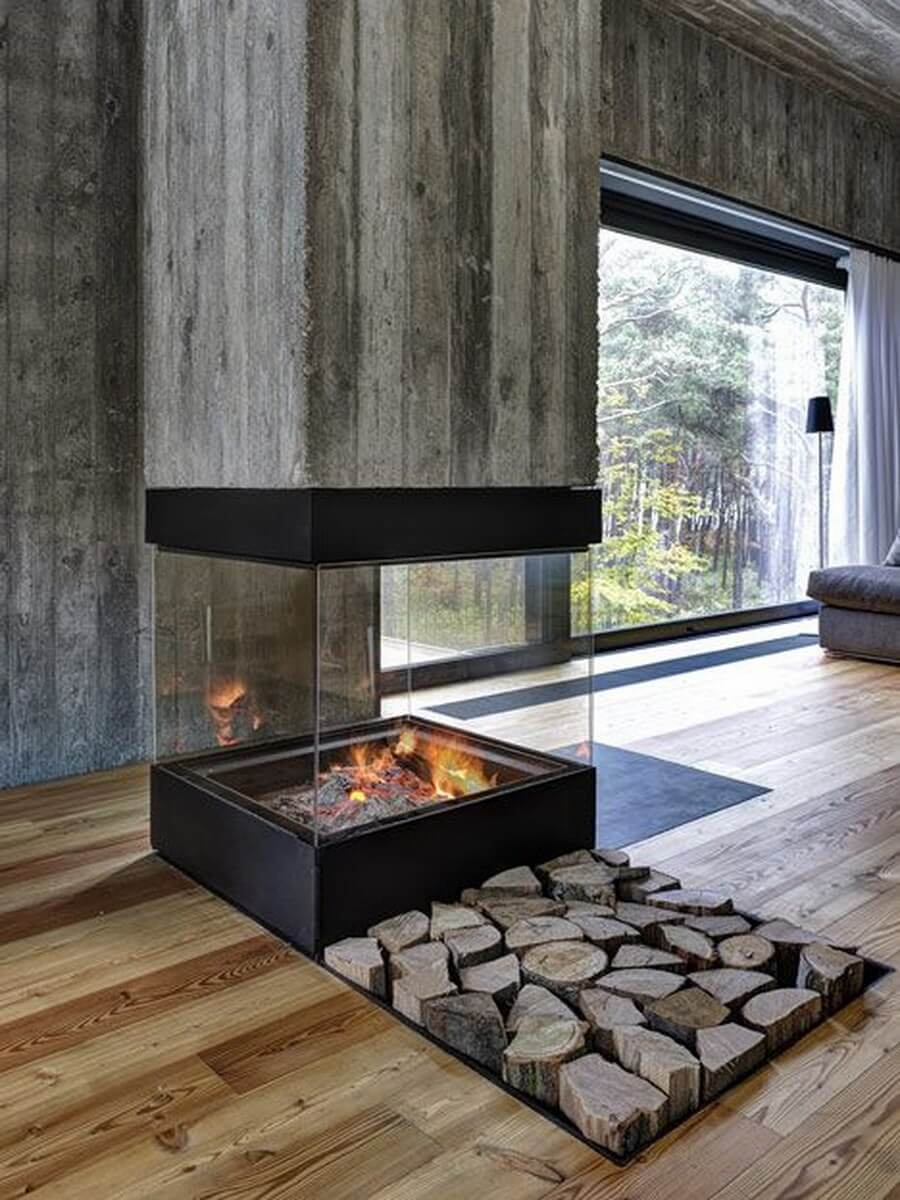 Industrial glass fireplace with cut fire wood