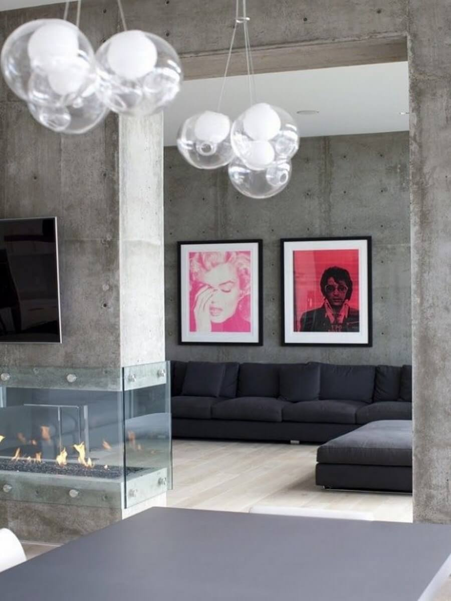 Modern 360 degree fireplace in cement wall in living room