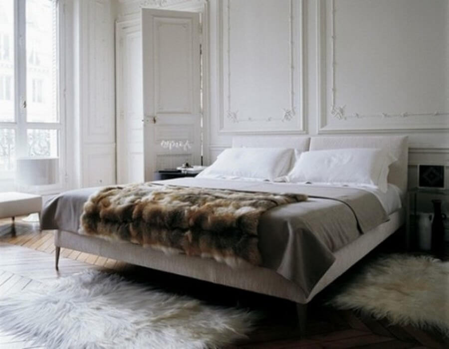 Furry bed in a masculine bright bedroom