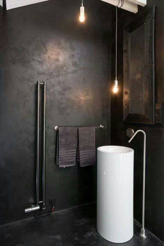 Black industrial bathroom with bold white sink