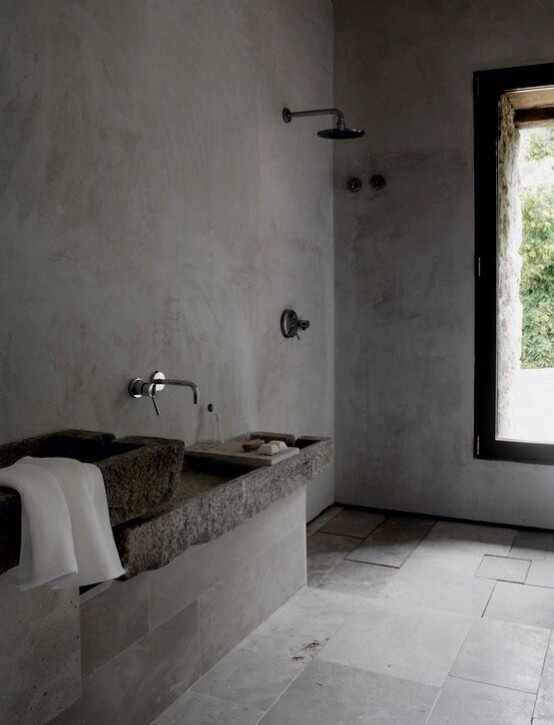 Bold stone and concrete bathroom