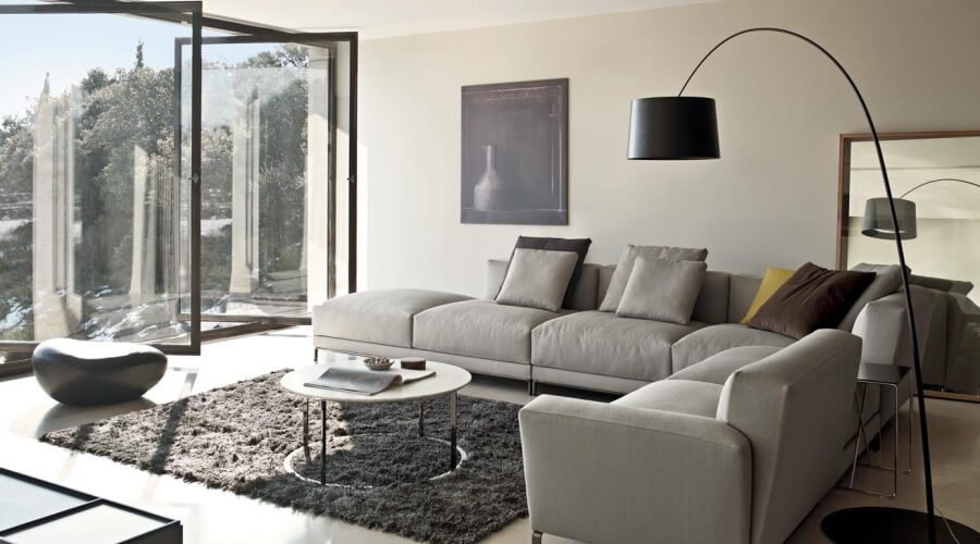 Grey Minimalist Living Room with Black FLoakti Rug