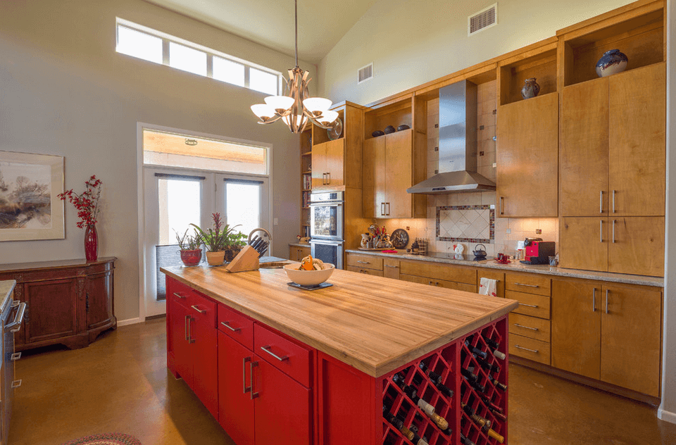 Red kitchen island with wine rack storage