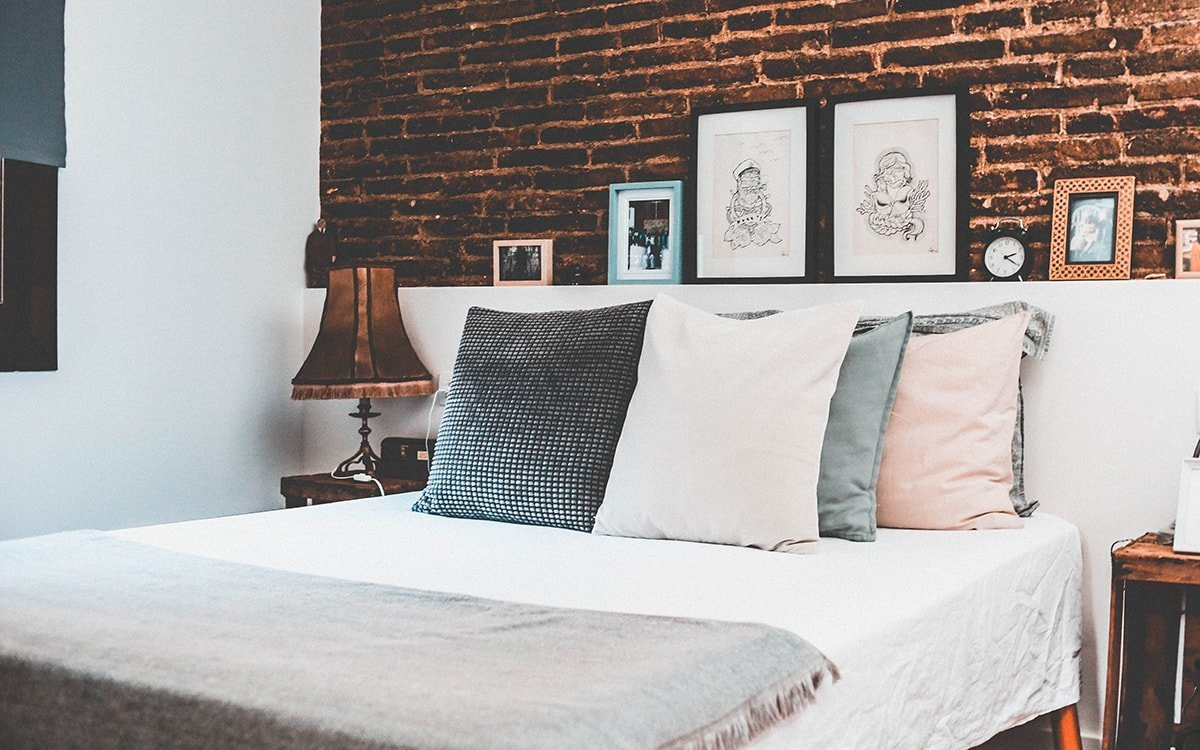 Bed with a brick headboard