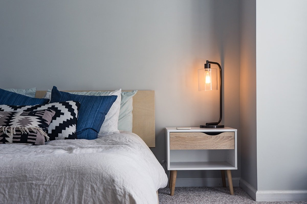 Bed with lamp and side table