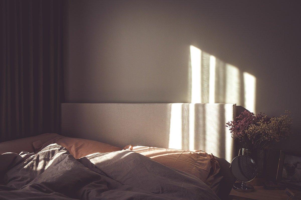 Bed in a dark bedroom