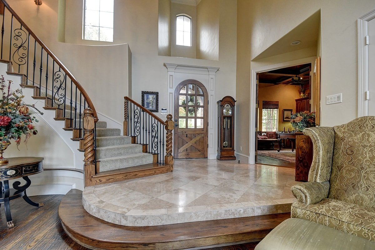 Large wooden staircase with carpet runner