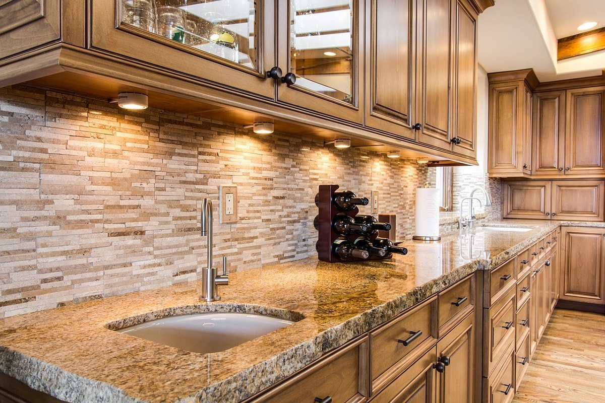 Kitchen with granite, wood and tile materials