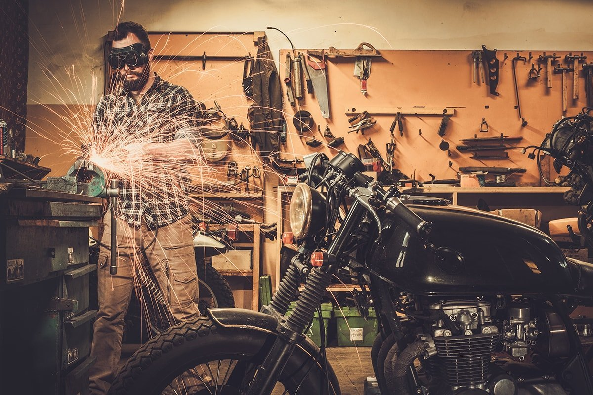 Man working on motorcycle in garage