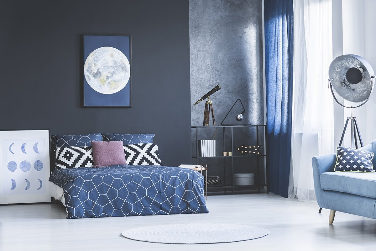 Dark blue bedroom with curtains