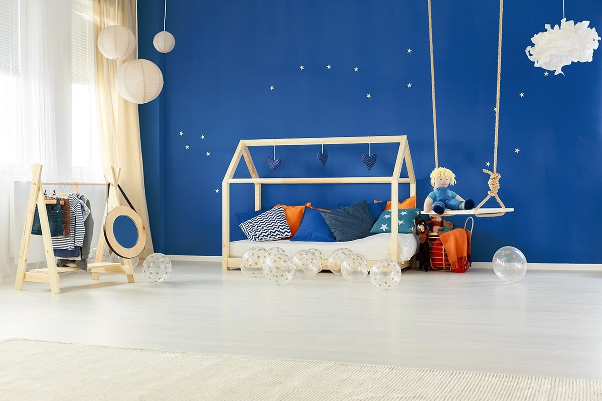 Wide open child's room with blue wall and swing