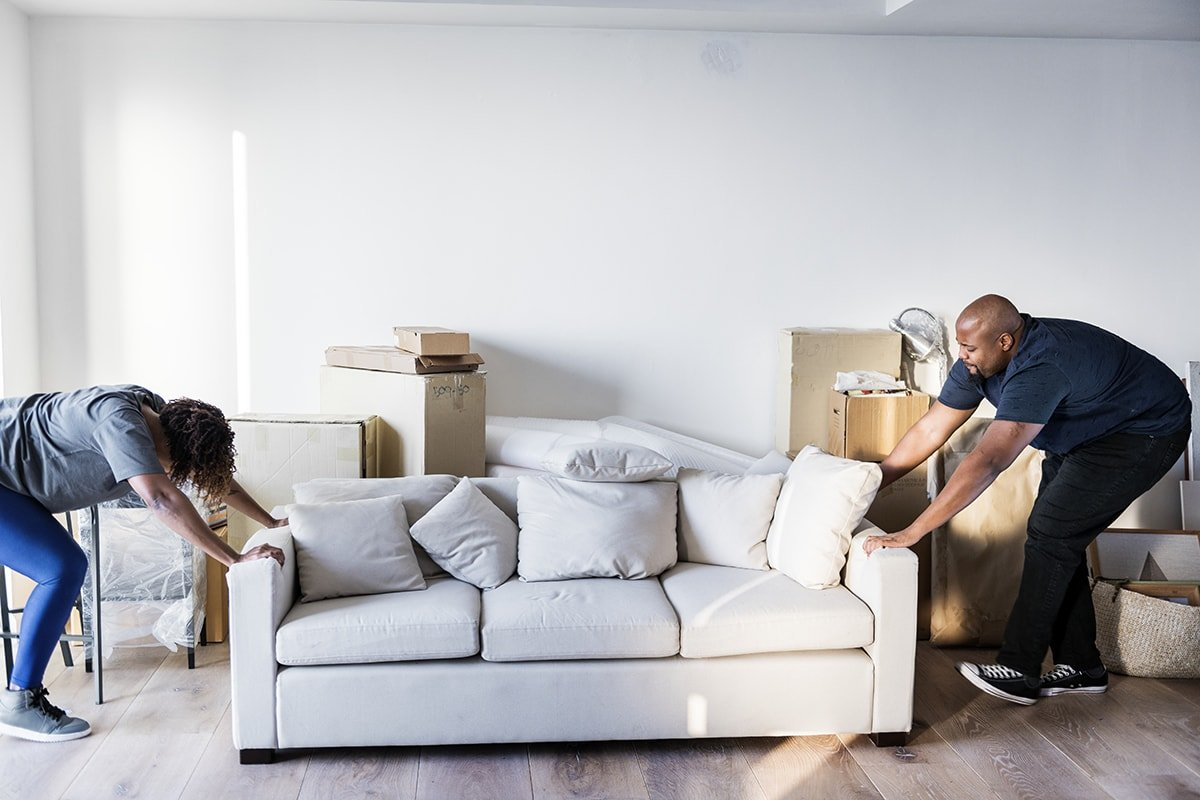 Couple moving furniture to prepare for renovations