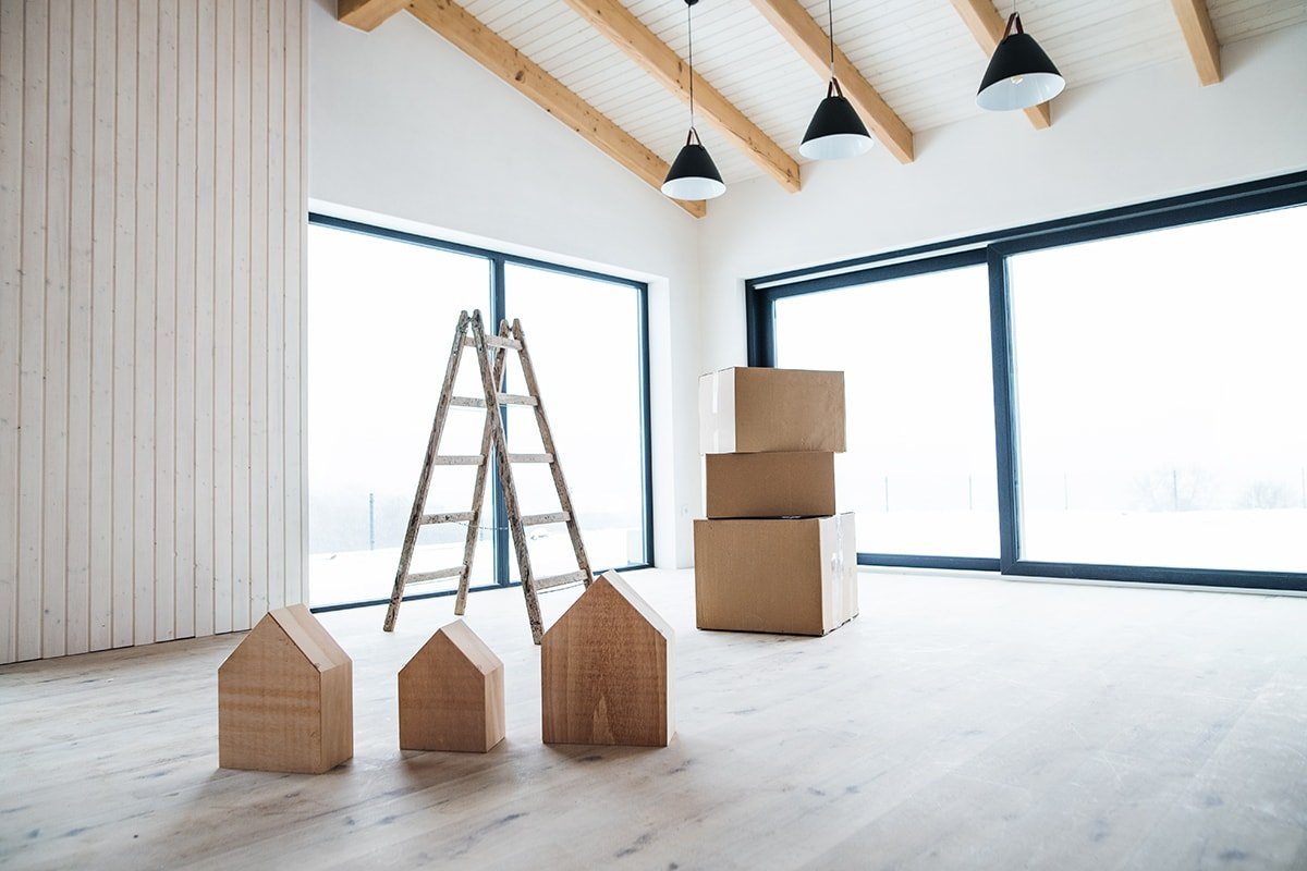 Bright empty house with moving boxes
