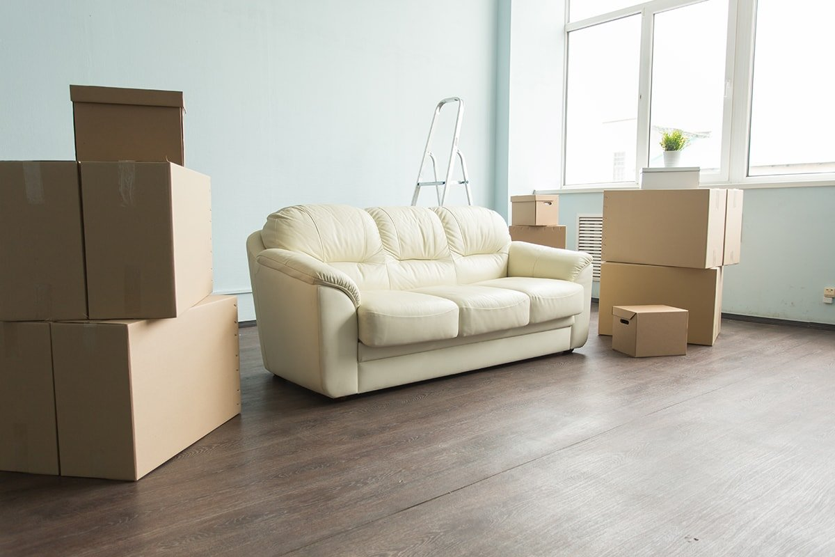 Empty room with boxes and couch